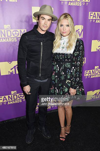 Actors Tyler Blackburn and Ashley Benson attend the MTV Fandom Awards San Diego at PETCO Park on July 9 2015 in San Diego California