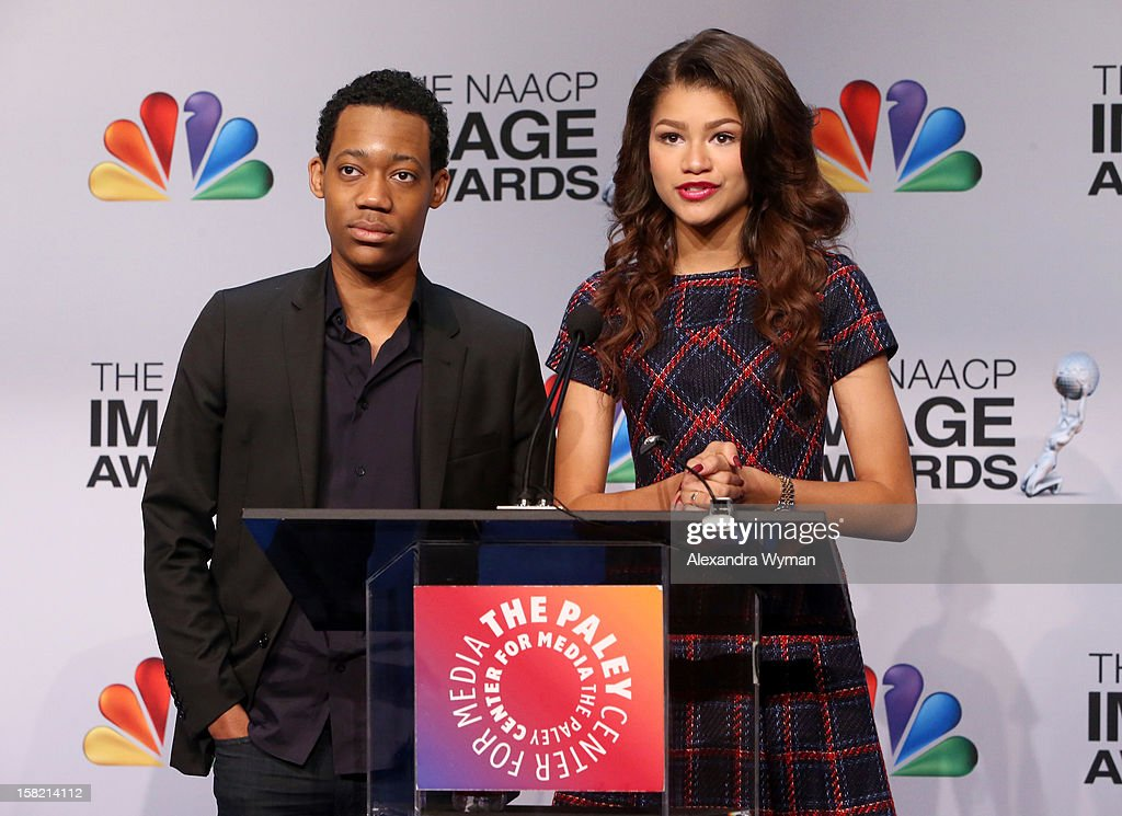 Actors Tyler James Williams and Zendaya speak at the podium onstage at the 44th NAACP Image Awards Nominations Announcement Press Conference at The Paley Center for Media on December 11, 2012 in Beverly Hills, California.