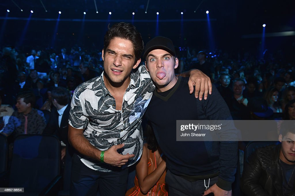Actors Tyler Posey and Dylan Sprayberry in the audience during the 2015 MTV Video Music Awards at Microsoft Theater on August 30 2015 in Los Angeles...