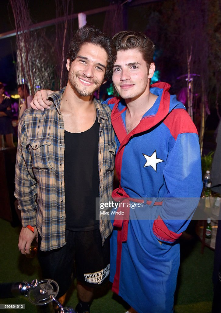 Actors Tyler Posey and Gregg Sulkin attend the annual Midsummer Night's Dream party hosted by Hugh Hefner at The Playboy Mansion on August 27 2016 in...