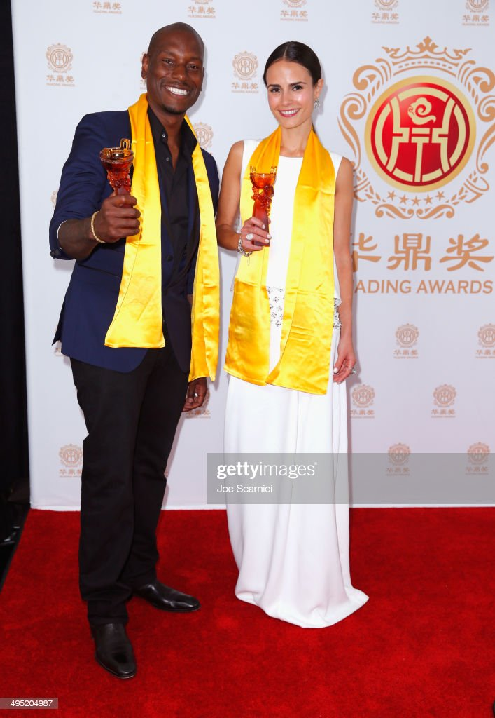 Actors <a gi-track='captionPersonalityLinkClicked' href=/galleries/search?phrase=Tyrese&family=editorial&specificpeople=206177 ng-click='$event.stopPropagation()'>Tyrese</a> Gibson (L) and <a gi-track='captionPersonalityLinkClicked' href=/galleries/search?phrase=Jordana+Brewster&family=editorial&specificpeople=207174 ng-click='$event.stopPropagation()'>Jordana Brewster</a> pose with the Best Global Movie of the Year award for 'Fast & Furious 6' in the press room during the Huading Film Awards on June 1, 2014 at Ricardo Montalban Theatre in Los Angeles, California. Huading Film Awards is China's #1 Film awards, in the U.S. for the first time.