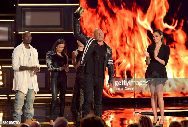 Actors Tyrese Gibson Michelle Rodriguez Jordanna Brewster Vin Diesel and Gal Gadot speak onstage during the 2017 MTV Movie And TV Awards at The...