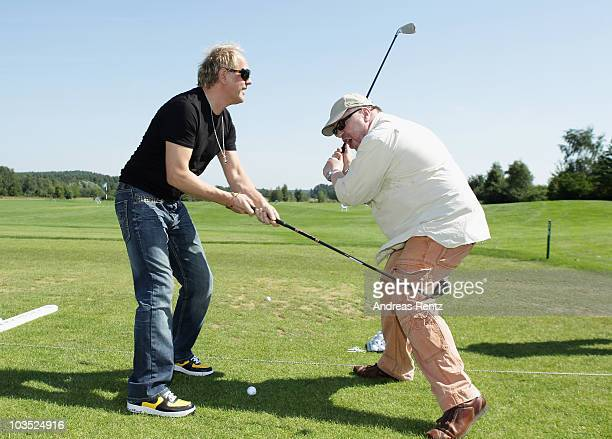 Actors Uwe Ochsenknecht and Armin Rohde attend the BMW Adlon Golf Cup 2010 at Golf and Country Club Seddiner See on August 21 2010 in Michendorf near...