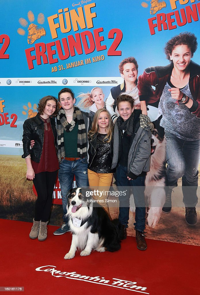 Actors Valeria Eisenbart, Quirin Oettl, Neele Marie Nickel and Justus Schlingensiepen and dog Coffey attend the 'Fuenf Freunde 2' movie premiere at CineMaxx Cinema on January 27, 2013 in Munich, Germany.