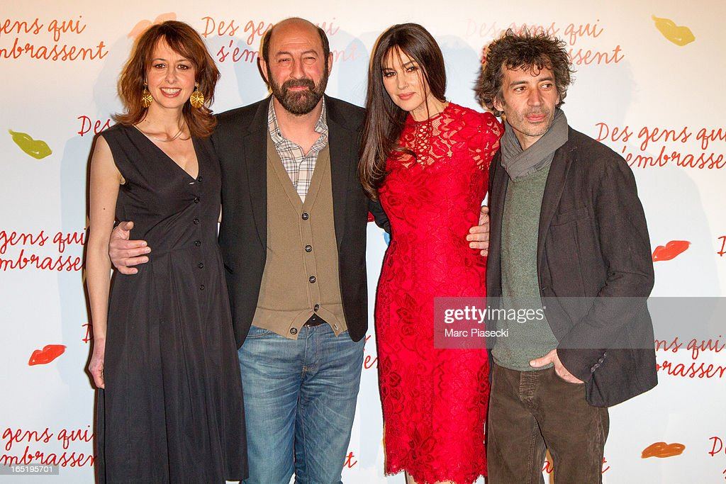 Actors Valerie Bonneton, Kad Merad, Monica Bellucci and Eric Elmosnino attend the 'Des Gens Qui S'embrassent' Premiere at Cinema Gaumont Marignan on April 1, 2013 in Paris, France.