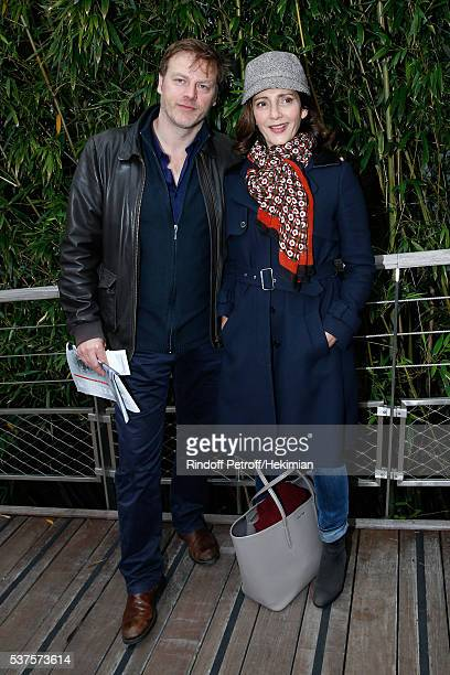 Actors Valerie Karsenti and her husband Francois Feroleto attend Day Twelve of the 2016 French Tennis Open at Roland Garros on June 2 2016 in Paris...