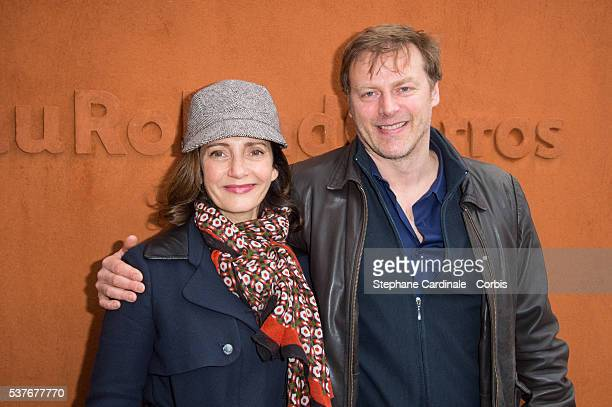 Actors Valerie Karsenti and her husband Francois Feroleto attend day twelve of the 2016 French Open at Roland Garros on June 2 2016 in Paris France