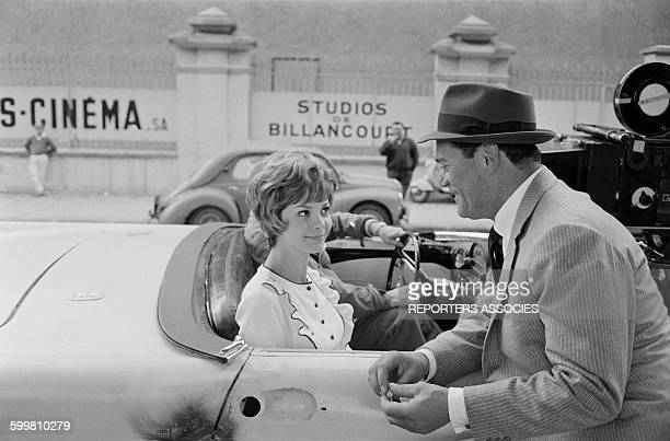Actors Valérie Boisgel and Eddie Constantine on the Set of the Movie 'Alphaville' Directed by JeanLuc Godard at the Studios of Boulogne in...