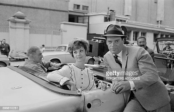 Actors Valérie Boisgel and Eddie Cosntantine on the Set of the Movie 'Alphaville' Directed by JeanLuc Godard in Paris France in 1965