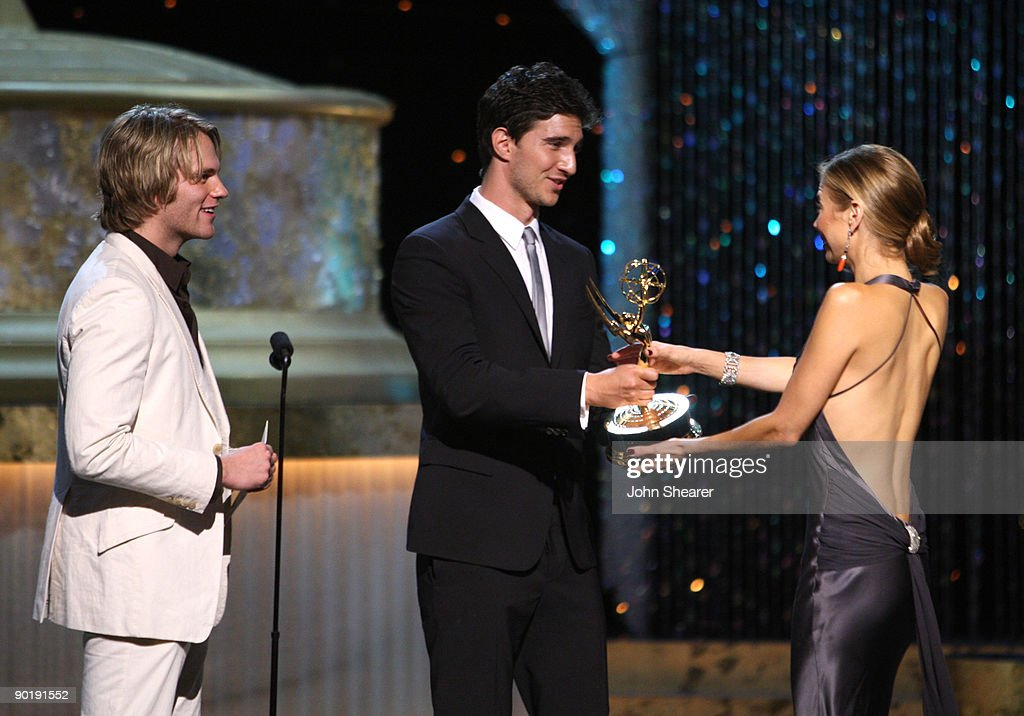 Actors Van Hansis (L) and Jake Silbermann present actress Tamara Braun the Emmy for Outstanding Supporting Actress in a Drama Series during the 36th Annual Daytime Emmy Awards at The Orpheum Theatre on August 30, 2009 in Los Angeles, California.