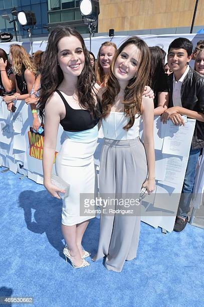 Actors Vanessa Marano and Laura Marano attend The 2015 MTV Movie Awards at Nokia Theatre LA Live on April 12 2015 in Los Angeles California