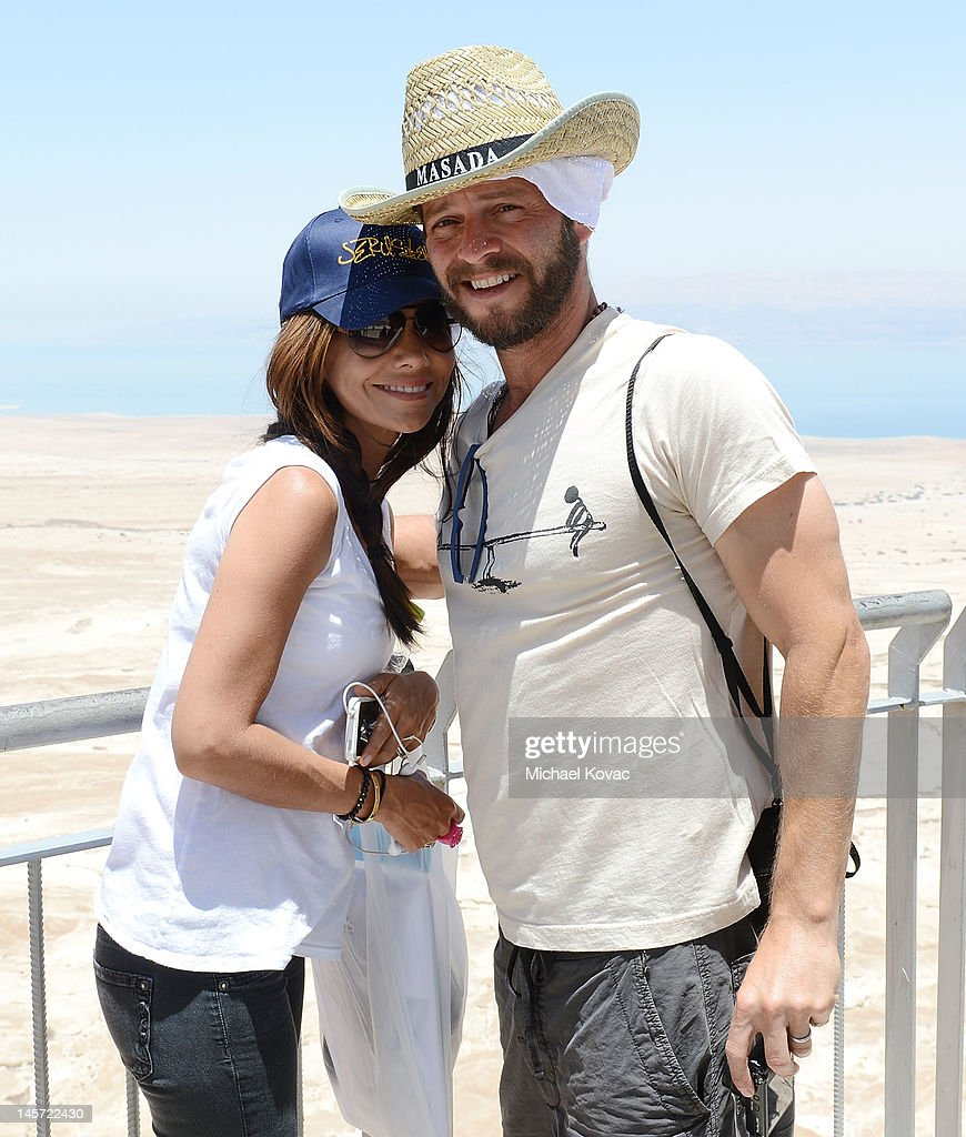 Actors <a gi-track='captionPersonalityLinkClicked' href=/galleries/search?phrase=Vanessa+Marcil&family=editorial&specificpeople=212875 ng-click='$event.stopPropagation()'>Vanessa Marcil</a> (L) and <a gi-track='captionPersonalityLinkClicked' href=/galleries/search?phrase=Carmine+Giovinazzo&family=editorial&specificpeople=225065 ng-click='$event.stopPropagation()'>Carmine Giovinazzo</a> visit Masada on June 3, 2012 in Masada, Israel.