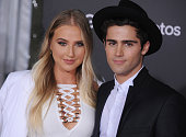 Actors Veronica Dunne and Max Ehrich arrive at the premiere of Walt Disney Animation Studios' 'Zootopia' at the El Capitan Theatre on February 17...
