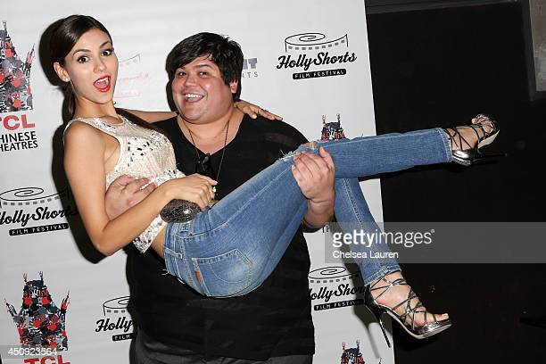 Actors Victoria Justice and Harvey Guillen arrive at the HollyShorts screening of 'Chocolate Milk' at TCL Chinese Theatre on June 19 2014 in...