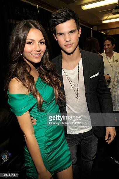 COVERAGE** Actors Victoria Justice and Taylor Lautner backstage at Nickelodeon's 23rd Annual Kids' Choice Awards held at UCLA's Pauley Pavilion on...