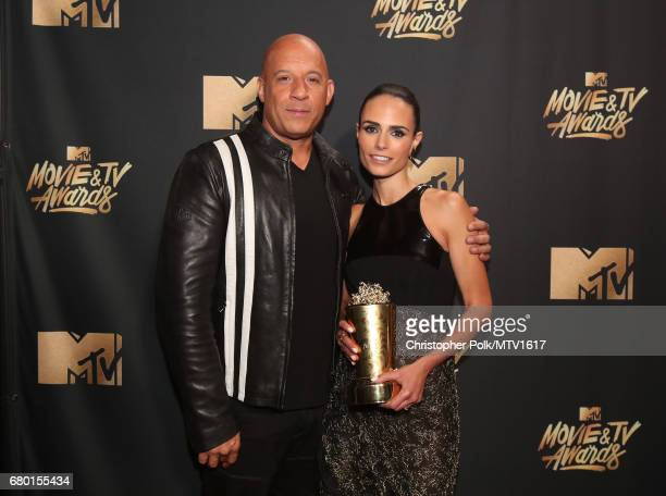 Actors Vin Diesel and Jordana Brewster pose with the MTV Generation Award for 'The Fast and the Furious' franchise at the 2017 MTV Movie And TV...