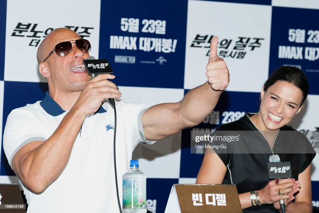 Actors <a gi-track='captionPersonalityLinkClicked' href=/galleries/search?phrase=Vin+Diesel&family=editorial&specificpeople=171983 ng-click='$event.stopPropagation()'>Vin Diesel</a> and <a gi-track='captionPersonalityLinkClicked' href=/galleries/search?phrase=Michelle+Rodriguez&family=editorial&specificpeople=206182 ng-click='$event.stopPropagation()'>Michelle Rodriguez</a> attend the 'Fast & Furious 6' press conference on May 13, 2013 in Seoul, South Korea.