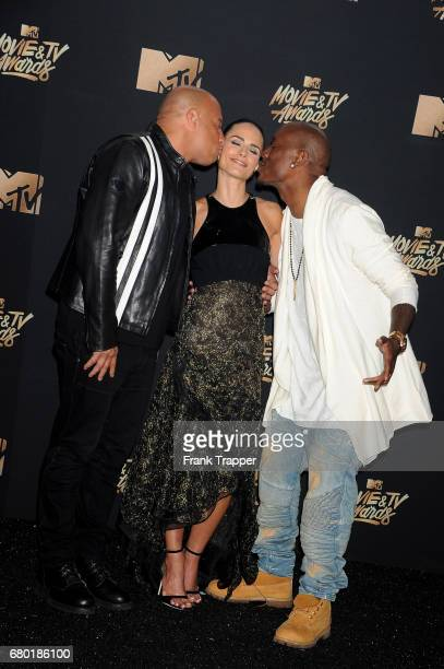 Actors Vin Diesel Jordana Brewster and Tyrese Gibson winners of the Generation Award pose in the press room during the 2017 MTV Movie And TV Awards...