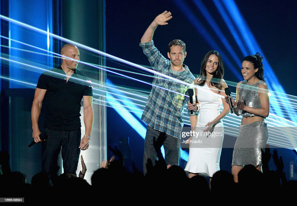 Actors Vin Diesel, Paul Walker, Jordana Brewster and Michelle Rodriguez speak onstage during the 2013 MTV Movie Awards at Sony Pictures Studios on April 14, 2013 in Culver City, California.