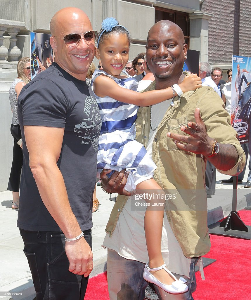 Actors Vin Diesel, Tyrese Gibson and daughter Shayla Somer Gibson arrive at the premiere of the 'Fast & Furious - Supercharged' Ride at Universal Studios Hollywood on June 23, 2015 in Universal City, California.