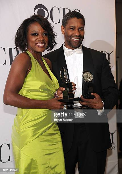 Actors Viola Davis and Denzel Washington pose with their awards at the 64th Annual Tony Awards at The Sports Club/LA on June 13 2010 in New York City