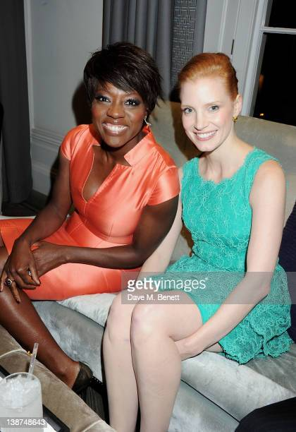 Actors Viola Davis and Jessica Chastain attend the Dreamworks PreBAFTA Tea Party in celebration of 'The Help' and 'War Horse' at The Arts Club on...