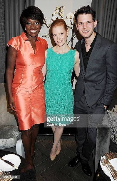 Actors Viola Davis Jessica Chastain and Jeremy Irvine attend the Dreamworks PreBAFTA Tea Party in celebration of 'The Help' and 'War Horse' at The...