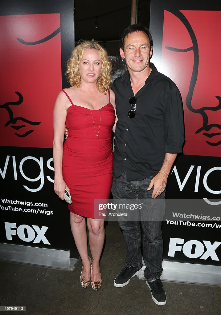 Actors Virginia Madsen (L) and Jason Isaacs (R) attend the one year anniversary celebration for the WIGS digital channel at Akasha Restaurant on May 2, 2013 in Culver City, California.