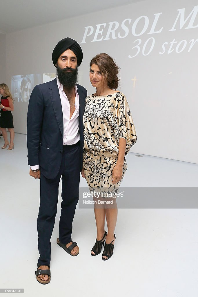 Actors <a gi-track='captionPersonalityLinkClicked' href=/galleries/search?phrase=Waris+Ahluwalia&family=editorial&specificpeople=887610 ng-click='$event.stopPropagation()'>Waris Ahluwalia</a> (L) and <a gi-track='captionPersonalityLinkClicked' href=/galleries/search?phrase=Marisa+Tomei&family=editorial&specificpeople=201516 ng-click='$event.stopPropagation()'>Marisa Tomei</a> attend the Persol Magnificent Obsessions event honoring Julie Weiss and Jeannine Oppewall at the MMI on July 10, 2013 in New York City.