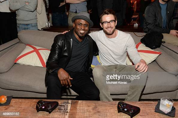 Actors Wayne Brady and Robert Buckley attend the Mortal Kombat X Tournament at The Microsoft Lounge on April 13 2015 in Venice California