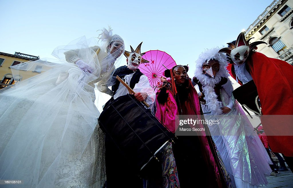 Actors wearing costumes performs ahead of the beginning of the water procession by French theatre company, Ilotopie, on January 26, 2013 in Venice, Italy. Today saw the opening of the Venetian Carnival, which runs till February 12th.