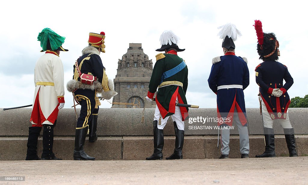 Actors wearing different uniforms from the time of the Napoleonic Wars (1803 - 1815) stand in front of the 'Voelkerschlachtdenkmal' memorial as festivities started to commemorate the 200th anniversary of the Battle of the Nations and the 100th anniversary of the 'Voelkerschlachtdenkmal' memorial to the Battle of the Nations on May 25, 2013 in Leipzig, eastern Germany. The battle, that took place from October 16 to 19, 1813, was fought between the coalition armies of Russia, Prussia, Austria and Sweden against the French army of Napoleon I.