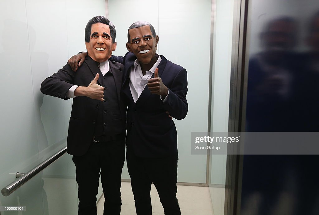 Actors wearing Mitt Romney (L) and Barack Obama masks stand in an elevator while attending a U.S. election party at the Bertelsmann Foundation on November 6, 2012 in Berlin, Germany. Polls suggest today's voting in American presidential elections will create a neck and neck race between incumbent Democrat President Barack Obama and his opponent, Republican Mitt Romney.