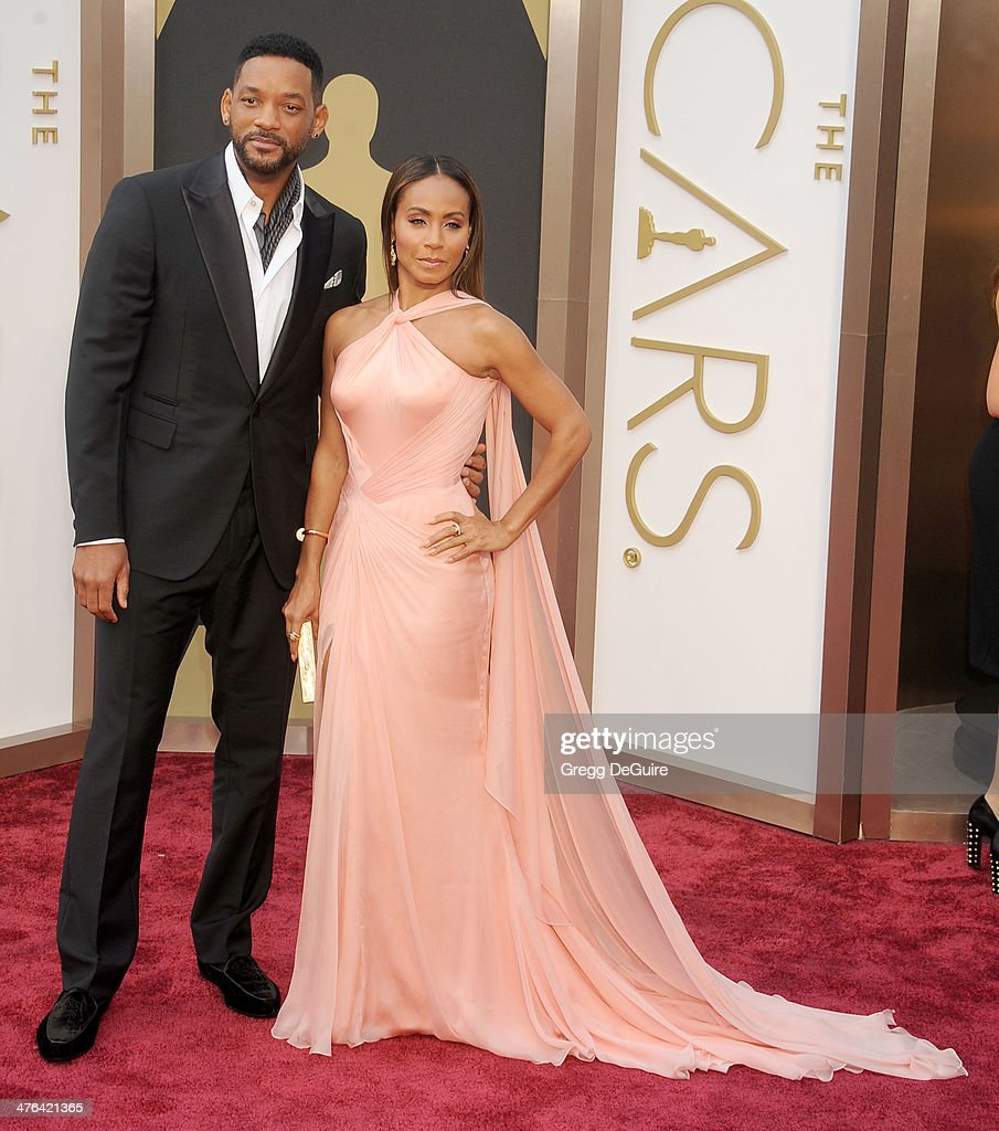 Actors Will Smith and Jada Pinkett Smith arrive at the 86th Annual Academy Awards at Hollywood & Highland Center on March 2, 2014 in Hollywood, California.