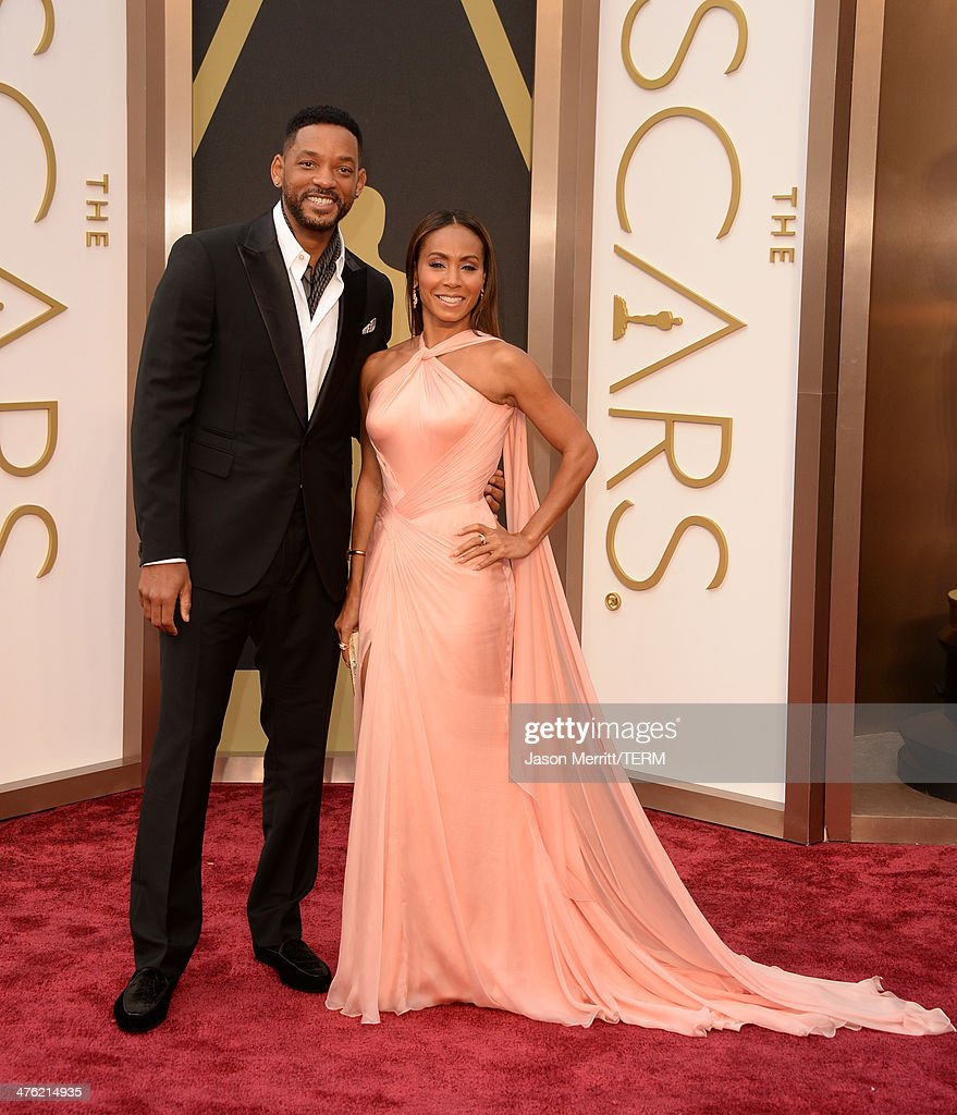 Actors Will Smith (L) and Jada Pinkett Smith attend the Oscars held at Hollywood & Highland Center on March 2, 2014 in Hollywood, California.