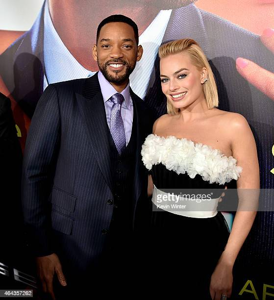 Actors Will Smith and Margot Robbie arrive at the premiere of Warner Bros Pictures' 'Focus' at the Chinese Theatre on February 24 2015 in Los Angeles...