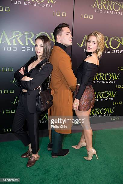 Actors Willa Holland Colton Haynes and Emily Bett Rickards arrive on the green carpet for the celebration of the 100th Episode of CW's 'Arrow' at the...
