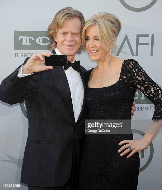 Actors William H Macy and Felicity Huffman arrive at the 2014 AFI Life Achievement Award Gala Tribute at Dolby Theatre on June 5 2014 in Hollywood...