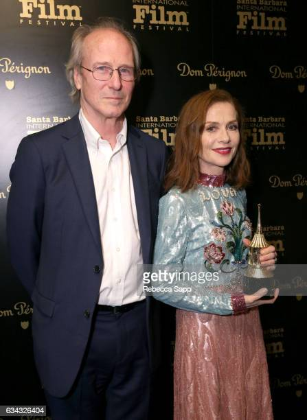 Actors William Hurt and Isabelle Huppert pose backstage at the Montecito Award during the 32nd Santa Barbara International Film Festival at the...