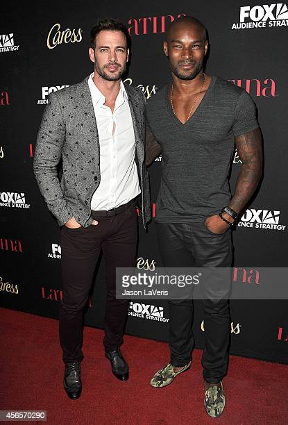 Actors William Levy and Tyson Beckford attend the Latina Magazine 'Hollywood Hot List' party at Sunset Tower Hotel on October 2 2014 in West...