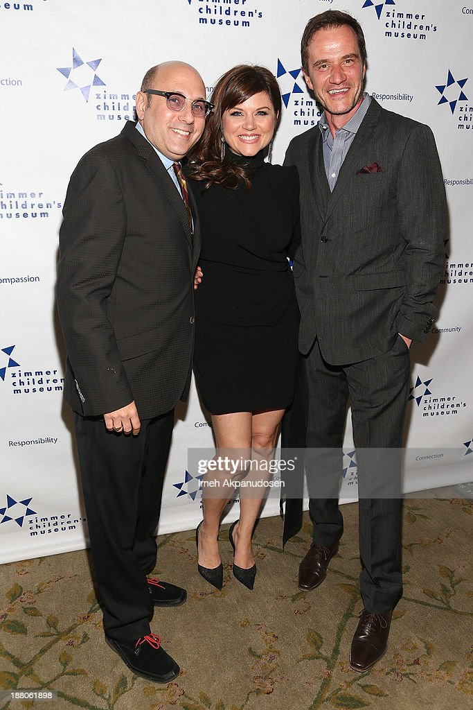 Actors <a gi-track='captionPersonalityLinkClicked' href=/galleries/search?phrase=Willie+Garson&family=editorial&specificpeople=240616 ng-click='$event.stopPropagation()'>Willie Garson</a>, <a gi-track='captionPersonalityLinkClicked' href=/galleries/search?phrase=Tiffani+Thiessen&family=editorial&specificpeople=221649 ng-click='$event.stopPropagation()'>Tiffani Thiessen</a>, and <a gi-track='captionPersonalityLinkClicked' href=/galleries/search?phrase=Tim+DeKay&family=editorial&specificpeople=808885 ng-click='$event.stopPropagation()'>Tim DeKay</a> attend the 13th Annual Discovery Award Dinner presented by the Zimmer Children's Museum at Beverly Hills Hotel on November 14, 2013 in Beverly Hills, California.