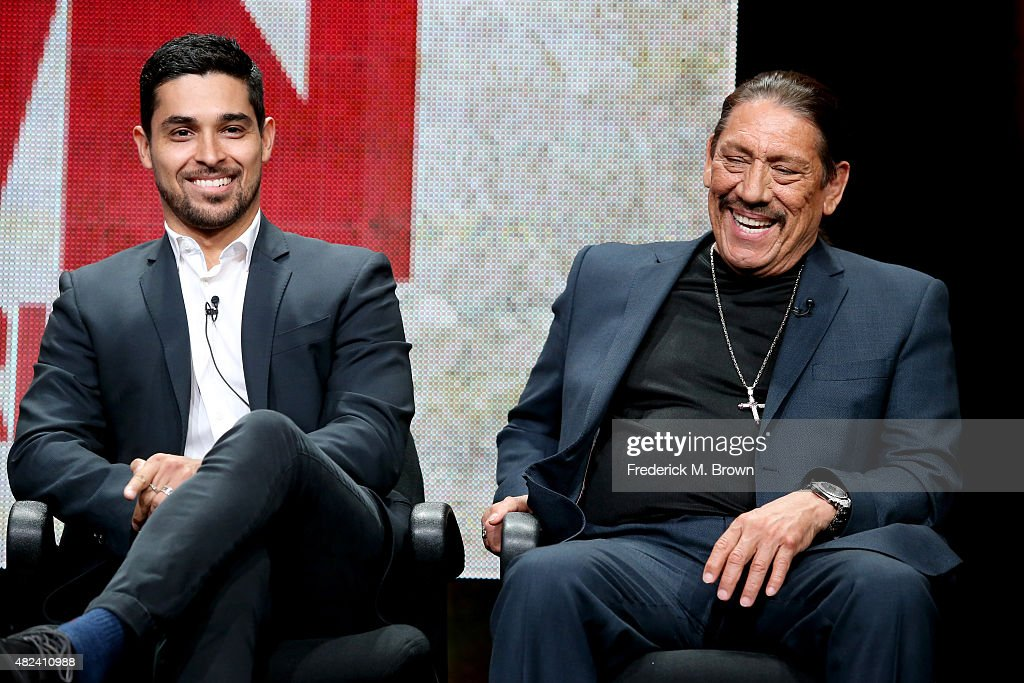 Actors Wilmer Valderrama (L) and Danny Trejo speak onstage during the 'From Dusk Til Dawn: The Series' panel discussion at the El Rey Network portion of the 2015 Summer TCA Tour at The Beverly Hilton Hotel on July 30, 2015 in Beverly Hills, California.