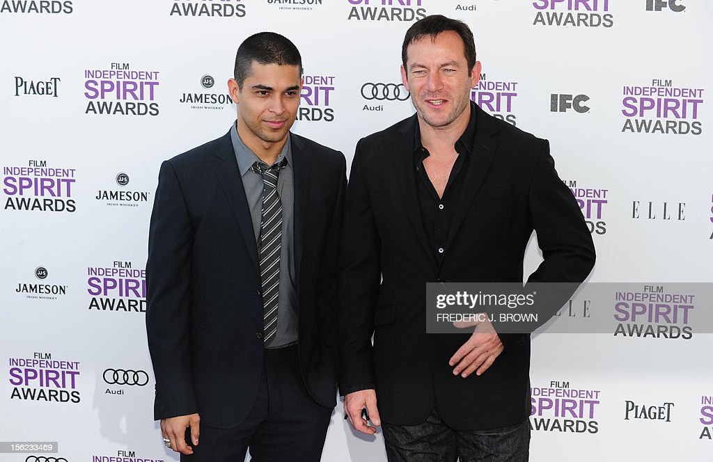 Actors Wilmer Valderrama and Jason Isaacs arrive on the red carpet on February 25, 2012 for the Independent Spirit Awards in Santa Monica, California. AFP PHOTO/FREDERIC J.BROWN