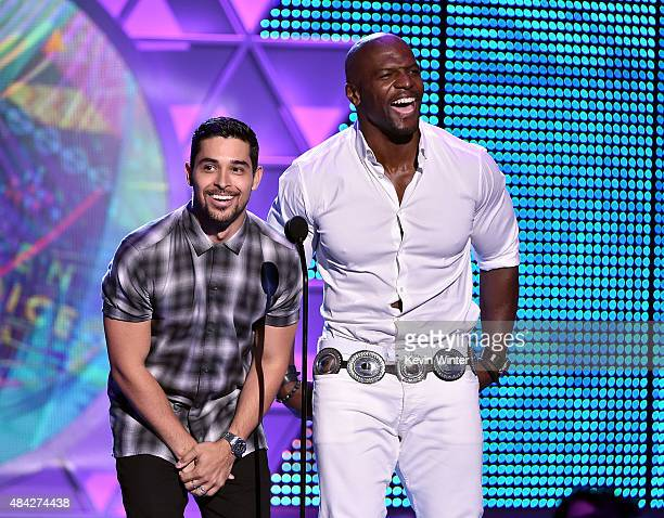 Actors Wilmer Valderrama and Terry Crews speak onstage during the Teen Choice Awards 2015 at the USC Galen Center on August 16 2015 in Los Angeles...