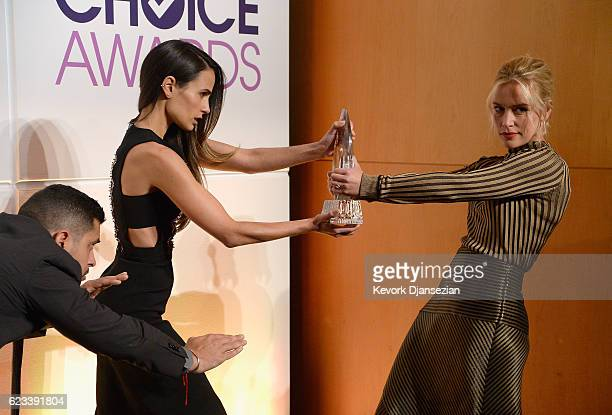 Actors Wilmer Valderrama Jordana Brewster and Piper Perabo hold the People's Choice Award during the People's Choice Awards Nominations Press...