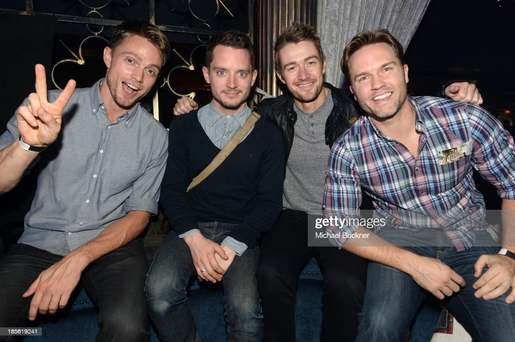 Actors Wilson Bethel, <a gi-track='captionPersonalityLinkClicked' href=/galleries/search?phrase=Elijah+Wood&family=editorial&specificpeople=171364 ng-click='$event.stopPropagation()'>Elijah Wood</a>, <a gi-track='captionPersonalityLinkClicked' href=/galleries/search?phrase=Robert+Buckley&family=editorial&specificpeople=981297 ng-click='$event.stopPropagation()'>Robert Buckley</a> and Scott Porter attend the Assasin's Creed IV Black Flag Launch Party at Greystone Manor Supperclub on October 22, 2013 in West Hollywood, California.