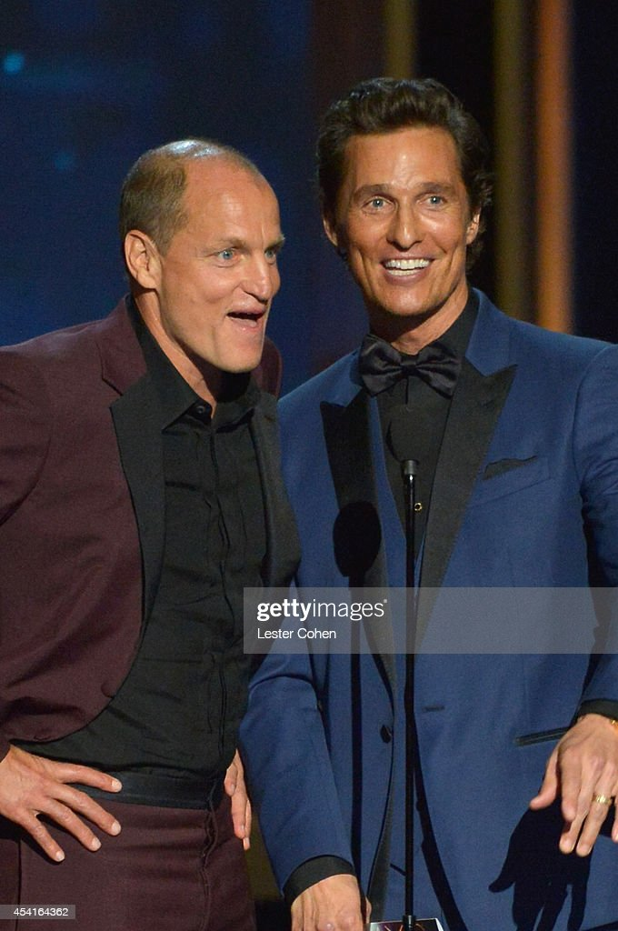 Actors Woody Harrelson (L) and Matthew McConaughey speak onstage at the 66th Annual Primetime Emmy Awards held at Nokia Theatre L.A. Live on August 25, 2014 in Los Angeles, California.