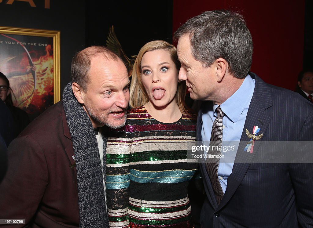 Actors <a gi-track='captionPersonalityLinkClicked' href=/galleries/search?phrase=Woody+Harrelson&family=editorial&specificpeople=208923 ng-click='$event.stopPropagation()'>Woody Harrelson</a>, <a gi-track='captionPersonalityLinkClicked' href=/galleries/search?phrase=Elizabeth+Banks&family=editorial&specificpeople=202475 ng-click='$event.stopPropagation()'>Elizabeth Banks</a> and vice chairman of Lionsgate <a gi-track='captionPersonalityLinkClicked' href=/galleries/search?phrase=Michael+Burns+-+Business+Person&family=editorial&specificpeople=226653 ng-click='$event.stopPropagation()'>Michael Burns</a> attend premiere of Lionsgate's 'The Hunger Games: Mockingjay - Part 2' at Microsoft Theater on November 16, 2015 in Los Angeles, California.