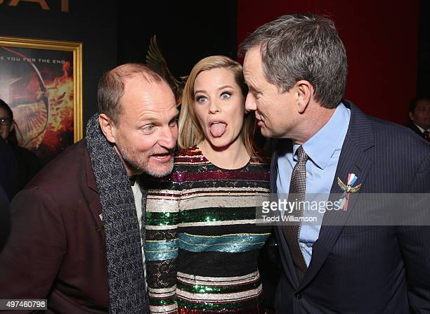 Actors Woody Harrelson Elizabeth Banks and vice chairman of Lionsgate Michael Burns attend premiere of Lionsgate's 'The Hunger Games Mockingjay Part...