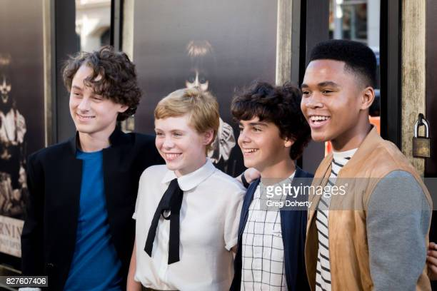Actors Wyatt Oleff Sophia Lillis Jack Dylan Grazer and Chosen Jacobs arrive for the Premiere Of New Line Cinema's 'Annabelle Creation' at the TCL...